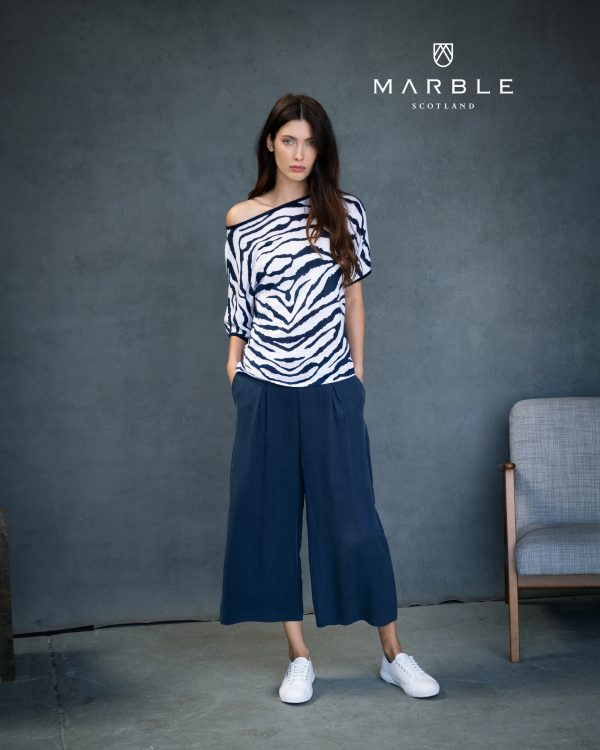 marble white coral & navy animal print top